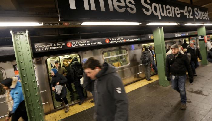 Commuters on Subway Platform